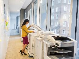 An employee with sarcoidosis has been having problems when needing to leave her workstation to use the copier due to her legs swelling when they are not elevated.