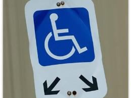 A financial manager in a securities firm who uses a wheelchair was accommodated with an accessible parking space and minor modifications to his workspace.