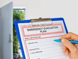 An office assistant with an intellectual disability became upset during emergency evacuation drills and could not remember how to evacuate the building.