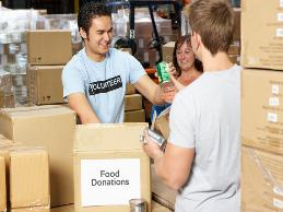 A volunteer at a food bank had a lifting restriction from a back condition and had trouble moving heavy donation deliveries to the sorting area.
