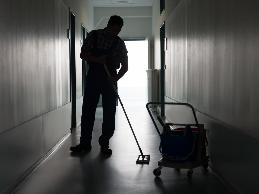 A janitor with cerebral palsy and balance problems was having problems walking about the facility and safely climbing ladders to change light bulbs.