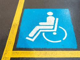 An employee with spina bifida had difficulty accessing the employer's parking lot.