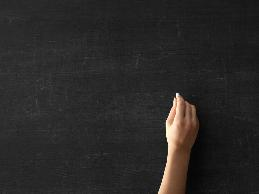 A teacher with cerebral palsy had difficulty manipulating papers and writing on the chalkboard.
