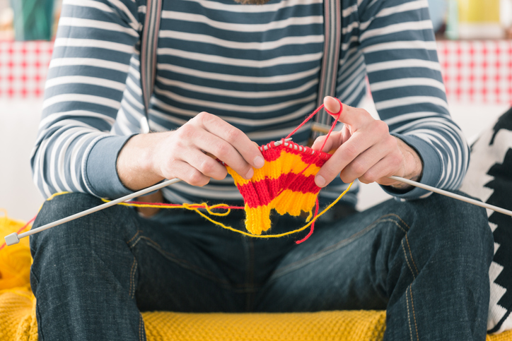 young man knitting